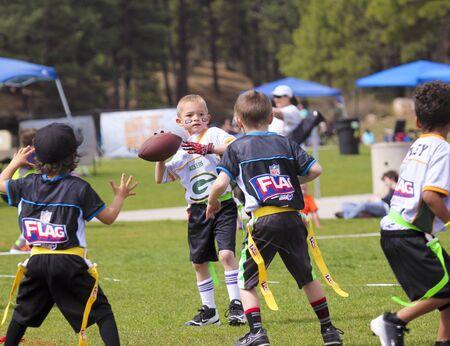 FLAGSTAFF, ARIZONA, MAY 14. Foxglenn Park on May 14, 2016, in Flagstaff, Arizona. A flag football game for 5 and 6 year olds at Foxglenn park in Flagstaff, Arizona. Editorial