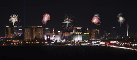 A view of the south end of Las Vegas Boulevard looking north at night with fireworks in Las Vegas, Nevada.