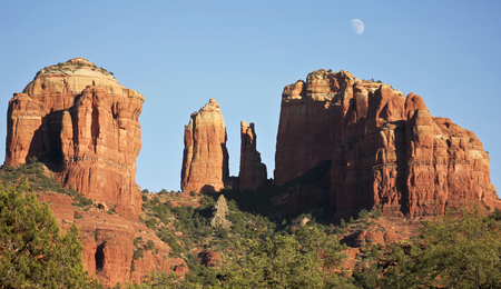 coconino national forest: A View of Sedonas Famous Cathedral Rock and Waxing Gibbous Moon