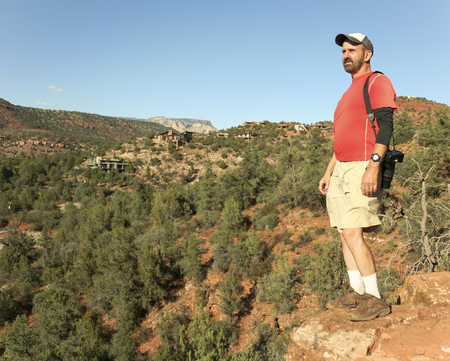 coconino national forest: A Man Takes in the View from the Famous Cathedral Rock Trail Near Sedona, Arizona Stock Photo