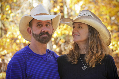 cowboy beard: A Portrait of a Married Couple with Autumn Leaves in the Background