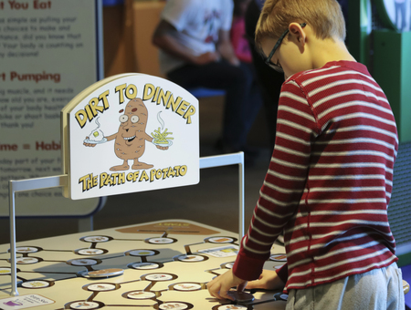 LAS VEGAS, NEVADA, DECEMBER 29. The Discovery Childrens Museum on December 29, 2016, in Las Vegas, Nevada. A Boy Learns About Potatos at the Discovery Childrens Museum in Las Vegas, Nevada. Editorial
