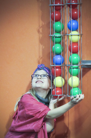 LAS VEGAS, NEVADA, DECEMBER 29. The Discovery Childrens Museum on December 29, 2016, in Las Vegas, Nevada. A Girl Plugs the Ball Shoot at the Discovery Childrens Museum in Las Vegas, Nevada.