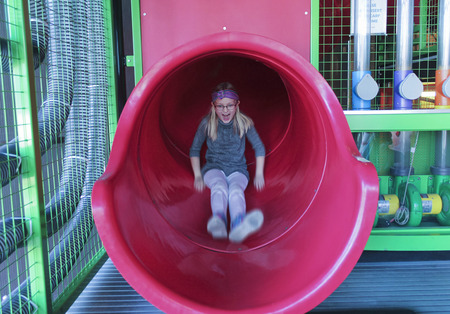 LAS VEGAS, NEVADA, DECEMBER 29. The Discovery Childrens Museum on December 29, 2016, in Las Vegas, Nevada. A Girl Rides Down a Big Red Slippery Slide Tube at the Discovery Childrens Museum in Las Vegas, Nevada. Editorial