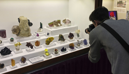 lapidary: TUCSON, ARIZONA, FEBRUARY 12. The Tucson Convention Center on February 12, 2017, in Tucson, Arizona. A photographer photographs the minerals at the Tucson Gem and Mineral Show in Tucson, Arizona.