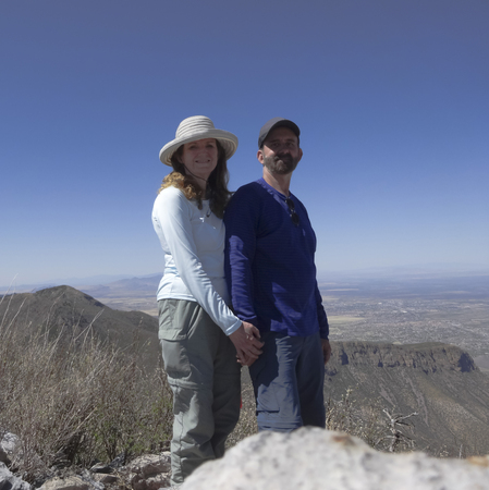 high sierra: A Smiling Couple Poses on the Summit of a Mountain Peak