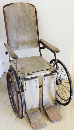 footplate: A Vintage Wooden Rolling Chair, Now Known as Wheelchair