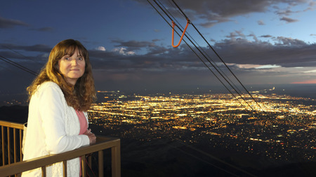 A Woman on the Sandia Peak Aerial Tramway Observation Deck in Albuquerque, NM, Just After Sunset Banco de Imagens