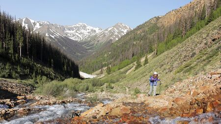 A Woman Hikes the Silver Creek Trail in Colorado