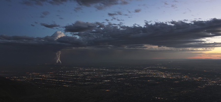 A Thunderstorm at Dusk Approaches the City of Albuquerque, New Mexico