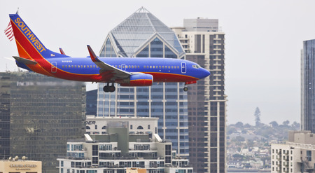 SAN DIEGO, CALIFORNIA, JUNE 7. Downtown on June 7, 2017, in San Diego, California. A Southwest Boeing 737, Flaps and Landing Gear Down, on Approach in San Diego in California. Editorial