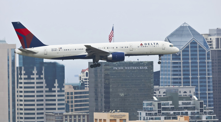 SAN DIEGO, CALIFORNIA, JUNE 7. Downtown on June 7, 2017, in San Diego, California.  A Delta  Air Lines Jet on Approach in San Diego in California. Editorial