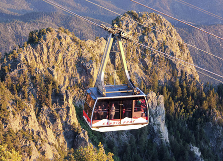 ALBUQUERQUE, NEW MEXICO, JUNE 18. The Sandia Peak Aerial Tramway Observation Deck on June 18, 2017, in Albuquerque, New Mexico. A Sandia Peak Aerial Tramway Uphill Tramcar Seen from the Observation Deck in Albuquerque, New Mexico. Editorial