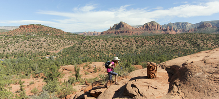 coconino national forest: A Woman Hikes the Trail Toward Famous Cathedral Rock Near Sedona, Arizona