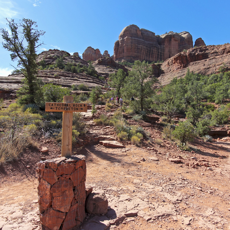 coconino national forest: SEDONA, ARIZONA, OCTOBER 11. The Cathedral Rock Trail on October 11, 2017, near Sedona, Arizona. A Cairn Sign Marking the Templeton and Cathedral Rock Trail Intersection Near Sedona in Arizona.