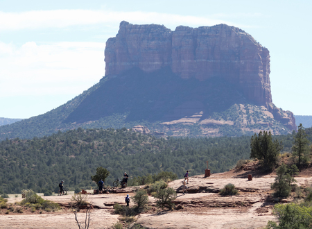 SEDONA, ARIZONA, OCTOBER 11. The Cathedral Rock Trail on October 11, 2017, near Sedona, Arizona. A Cairn Sign Marking the Templeton and Cathedral Rock Trail Intersection Near Sedona in Arizona. Courthouse Butte looms behind. Editorial