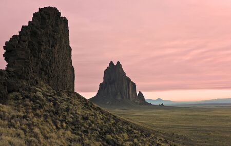 A Shiprock Landscape Against a Pink Dawn Sky, New Mexico, on the Navajo Reservation, west of the town of Shiprock.