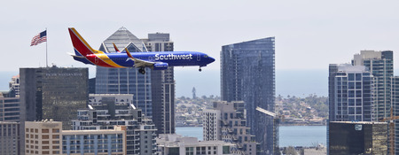 SAN DIEGO, CALIFORNIA, JUNE 9. Downtown on June 9, 2017, in San Diego, California. A Southwest Boeing 737, Flaps and Landing Gear Down, on Approach in San Diego in California.