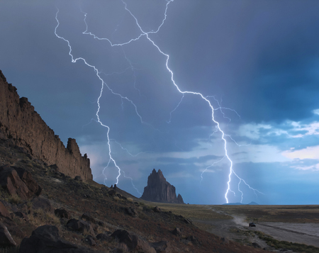 An SUV Races Away from a Thunderstorm at Shiprock in New Mexico