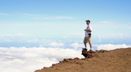 A Man Stands on the Edge of Puuulaula Summit, Haleakala National Park, Maui, Hawaii