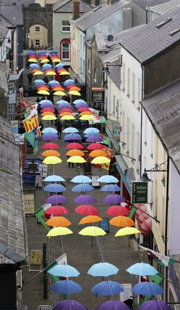 CAERNARFON, WALES, JUNE 11. Palace Street on June 11, 2019, in Caernarfon, Wales. A Street Full of Colorful Brollies, Palace Street, Caernarfon, Wales, Great Britain, United Kingdom.