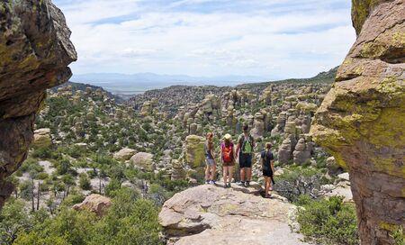 WILCOX, ARIZONA, AUGUST 18. Chiricahua National Monument on August 18, 2019, near Wilcox, Arizona. A Family Gazes at the Chiricahua National Monument, also known as the Land of Standing Up Rocks, Arizona, USA. 写真素材 - 129998644