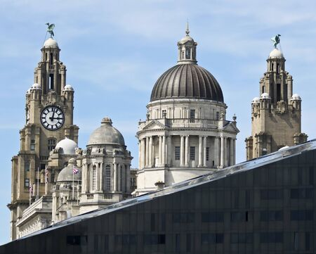 LIVERPOOL, ENGLAND, JUNE 9. Pier Head on June 9, 2019, in Liverpool, England. Liverpool, England, landmarks include The Royal Liver Building, Cunard Building, Port of Liverpool Building, Mann Island Building and Open Eye Gallery, Great Britain, United Kin