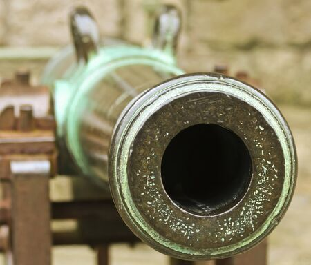 A Vintage British Cannon, Caernarfon Castle, Caernarfon, Wales, Great Britain, United Kingdom Stok Fotoğraf