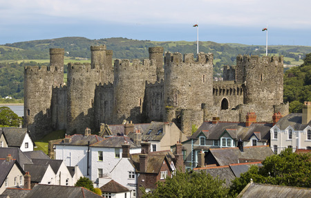 A View of Conwy Castle Rising Above the Rooftops, the Castle a Major Tourist Draw to Conwy, Wales, Great Britain, United Kingdom.