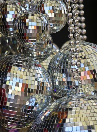An Assortment of Reflective Tile Ball Ornaments Hanging Together
