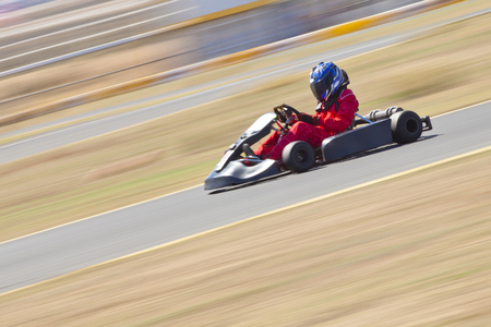 carting: Youth Go Kart Racer on Track