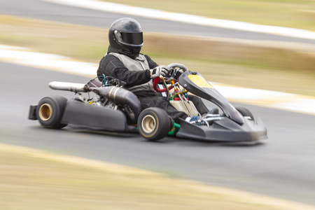 Go Kart Racer on Track, Panning Shot to show speed