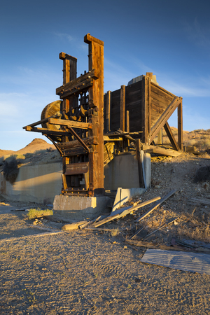 pershing: Old mining stamp mill in early morning light with blue sky.