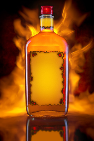 Bottle of whiskey with fire background Stock Photo