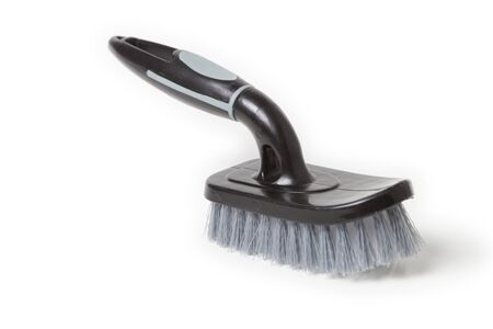 Handheld scrub brush for cleaning, isolated over white background.