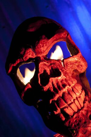 red skull with fire in eyes Stock Photo