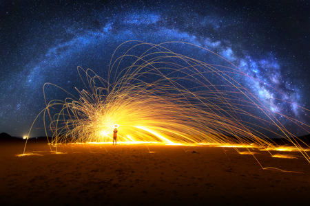 Arched Milky Way and Fiery Sparks on desert lake bed 版權商用圖片