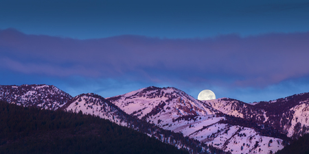 alpen: Moon rise over mountains with alpen glow pink light
