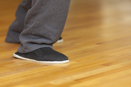 footwork: Tai Chi footwork and kung fu shoes, shallow depth of field, focus on shoe.