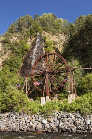 Waterfall and water wheel in Idaho Springs Colorado next to the I-70 Freeway.
