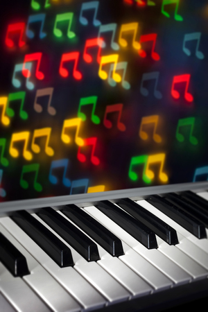Piano Keyboard with Bokeh Notes Banco de Imagens - 68177890