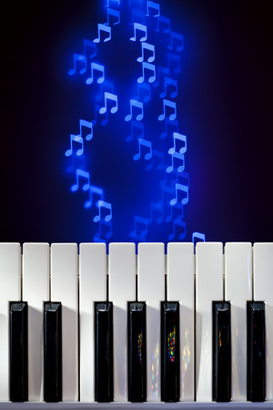 Piano Keyboard with Bokeh Notes