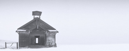 one room school house: old abandoned school house in winter snow
