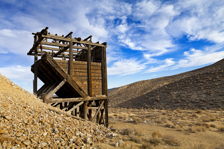sift: Old wooden mine workings in the Nevada desert. Head frames and bins were used to raise and sift materials. Stock Photo