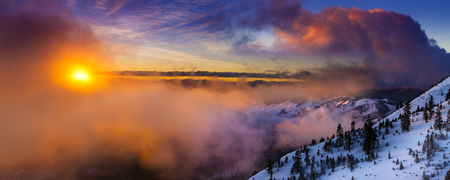 reno: Sunrise in winter on Slide Mountain near Reno, NV on the Mt. Rose Highway. Colorful clouds and snowy landscape. Stock Photo