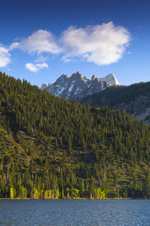 sawtooth national forest: Twin Lakes, Bridgeport, CA. Mountain lake with Saw Tooth mountain range and blue sky and clouds. Stock Photo