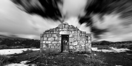 Ghost Town stone building in the Nevada Desert in Black and White.  Ione, NV