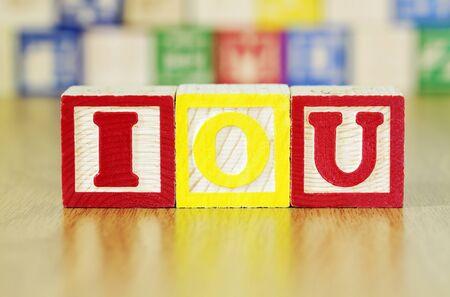 Alphabet Blocks Spelling out IOU Banco de Imagens