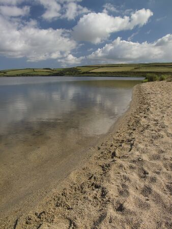 loe: Loe Pool, at Loe Bar, Cornwall. This lake was once part of the coastline, a sandbank built up cutting it off from the ocean.