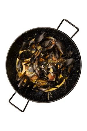 dinne: Prepared mussels in black saucepan isolated